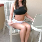 Steph outdoors in white hotpants