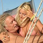 Light-haired beauty heads down and gets her slit fucked on a boat